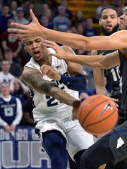 Utah State forward Dwayne Brown Jr. passes the ball