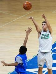 Fort Myers High School's Mark Matthews scores scores against Fort Lauderdale Dillard during FGCU's men's basketball team camp Friday at FGCU in Fort Myers.