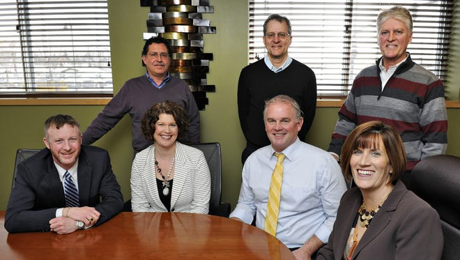Mahowald Insurance principals are (front row) Bob Mahowald, managing partner; Laura Tomczik, director of risk management; Dave Mahowald; Bridget Faber, director of employee benefits; (back row) Greg Murray, agency partner; Marty Mahowald, agency partner; and John Mahowald, producer. They were photographed in February 2015.