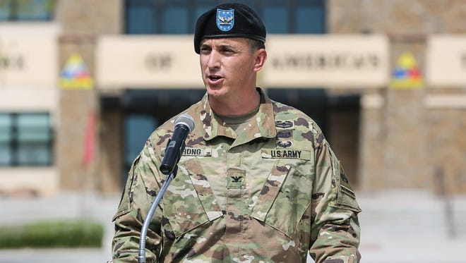 Col. Eric S. Strong speaks during his assumption of command ceremony last week. Strong, of Syracuse, N.Y., is the new commander of the 1st Brigade Combat Team.