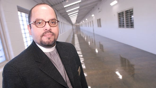 Jesus Huertas stands in the United States Penitentiary in Pollock, where he served as chaplain, in 2002.