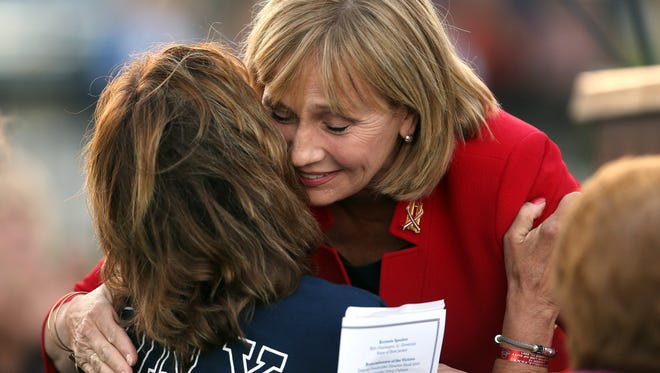 After her keynote speech, Lt. Governor Kim Guadagno comforts Loretta Viglione of Parsippany during the Morris County September 11th remembrance service and candlelight vigil. Loretta's brother Tommy Sabella, a FDNY firefighter was killed on 9/11. September 11, 2016, Parsippany, NJ