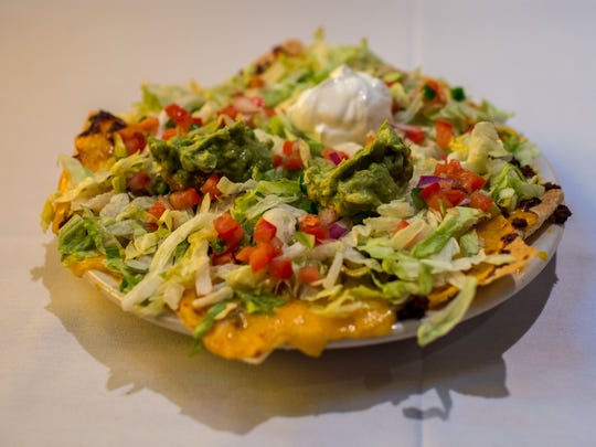 The super nacho, an off-menu appetizer, is pictured at La Fonda.