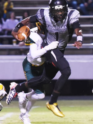 Parkway's Justin Rogers tries to get past Captain Shreve's defense Friday evening at Preston Crownover Stadium.
