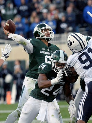 MSU junior quarterback Damion Terry (6) throws a pass in the second half of MSU's game against BYU Saturday. Terry finished 6 of 10 passing for 63 yards and an interception, replacing starter Tyler O'Connor.