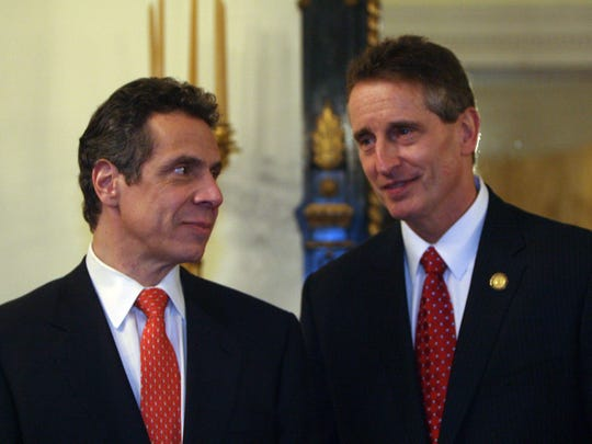 New York Gov. Andrew Cuomo huddles here with Lt. Gov. Robert Duffy at the Executive Mansion in Albany where they greeted citizens on Inauguration Day, Jan.1, 2011.