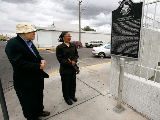 Maceo Crenshaw Dailey Jr., director of UTEP's African American Studies Program, and Bonita Johnson of the El Paso Community Foundation, examined a historical marker outside the old Douglass Grammar and High School at 515 S. Kansas on Monday.