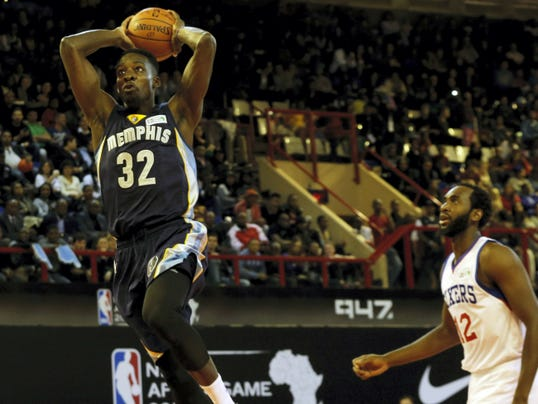 Team World's Jeff Green of Memphis Grizzlies, left, goes up for a shot as Team Africa's Luc Mbah a Moute of Philadelphia 76ers, looks on during the NBA Africa Game at Ellis Park Arena in Johannesburg, South Africa, on Saturday.