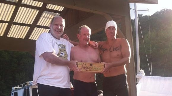 Roberson coach Jim Cottam, left, swam the length of Fontana Lake on Saturday for charity.