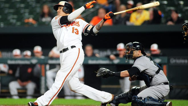 Sep 5, 2017; Baltimore, MD, USA; Baltimore Orioles third baseman Manny Machado (13) hits a walk off home run in the ninth inning to defeat the New York Yankees 7-6 at Oriole Park at Camden Yards. Mandatory Credit: Evan Habeeb-USA TODAY Sports