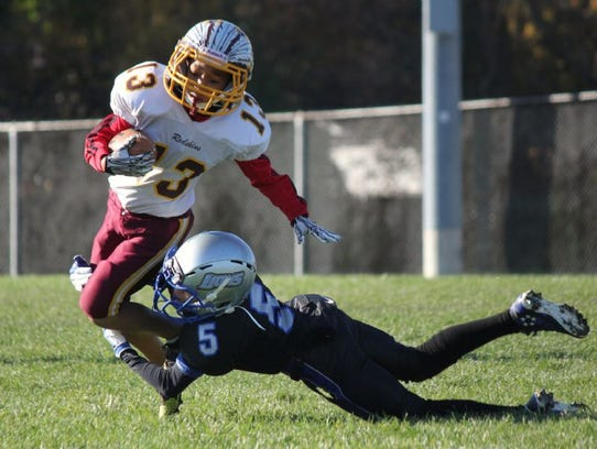 Caleb Williams (5) makes a diving tackle for the freshmen