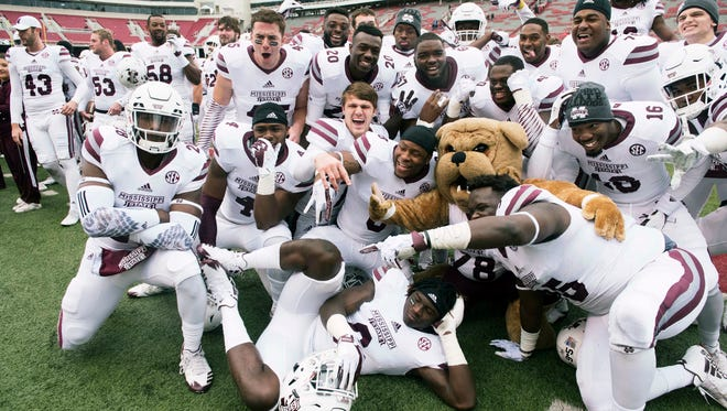 Mississippi State players celebrate after their 28-21 win over Arkansas.