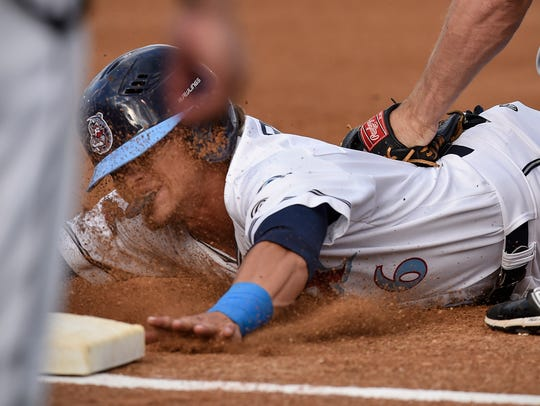 T.J. Friedl of the St. Cloud Rox tries to beat the