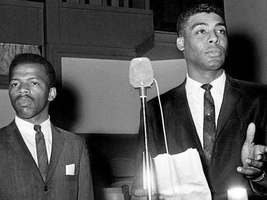 The Rev. Kelly Miller Smith, right, president of Nashville Christian Leadership Council and John Lewis, chairman of the Student Non-violence Committee of the NCLC, told a mass meeting of demonstrators May 10, 1963 at Mt. Zion Baptist Church on Jefferson St., not to protest in town until the outcome of the meeting between Nashville business officials and black leaders.