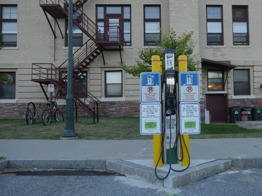 This electric car charging station, outside UVM's Davis Center, was built with Money from the Clean Energy Fund.