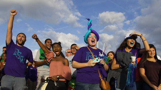 Florida Southwestern State College fans celebrate the opening of FSW's new arena Tuesday in south Fort Myers.