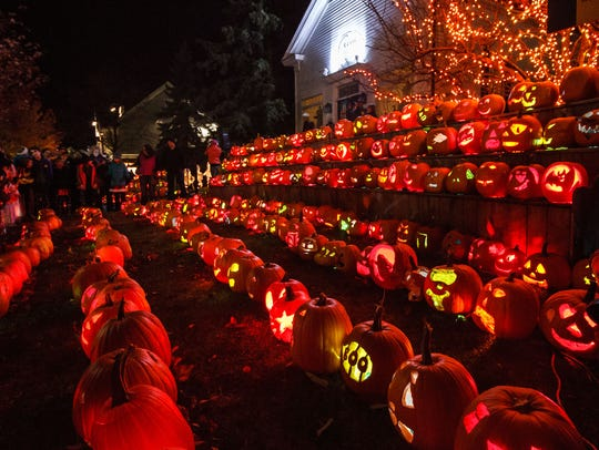 Spectators look on during the annual Halloween in Delafield