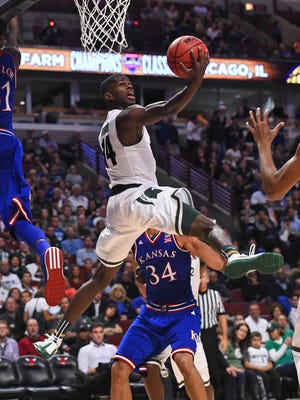 Michigan State Spartans guard Eron Harris attempts a reverse layup against Kansas during the first half of Tuesday night's game in Chicago. Harris missed the shot, finishing with two points in 10 minutes in the win.