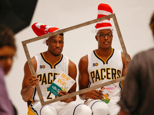 Indiana Pacers forwards Thaddeus Young (21) and Myles Turner (33) pose for a portrait during media day at Bankers Life Fieldhouse on Sept. 25, 2016.