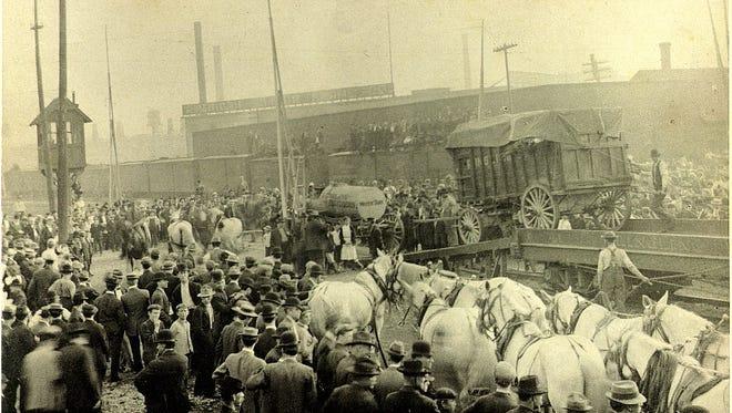 Unloading the circus at the Sheboygan railroad depot on Pennsylvania Avenue.