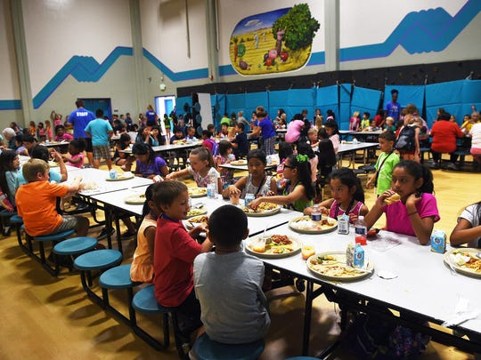 Children eat lunch at the Boys and Girls Club of Truckee Meadows as part of the U.S. Department of Agriculture Summer Food Service Program in Reno on June 16, 2015. The program is organized in conjunction with the Food Bank of Northern Nevada.