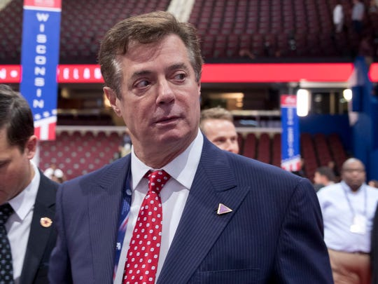 In this July 18, 2016 file photo, then-Trump campaign chairman Paul Manafort walks around the convention floor before the opening session of the Republican National Convention in Cleveland.