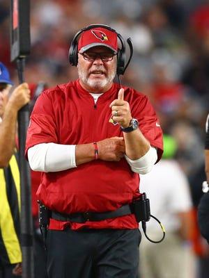 Arizona Cardinals head coach Bruce Arians reacts against the Oakland Raiders during a preseason game at University of Phoenix Stadium.