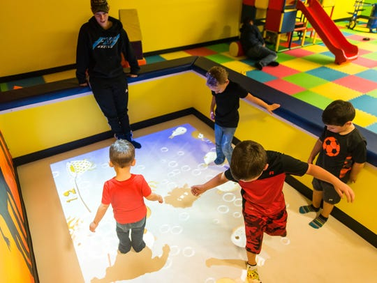 Vineland kids play with an interactive floor at The