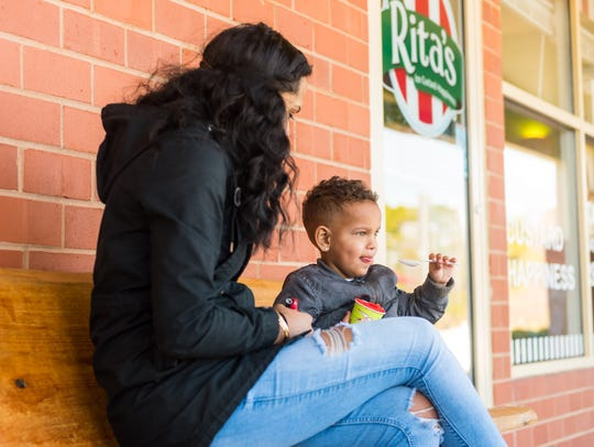 Miangelo Moyer, 2, reacts to his first taste of Rita's