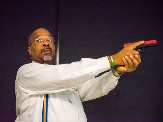 Bridgeton Mayor Albert B. Kelly learns how to use Laser