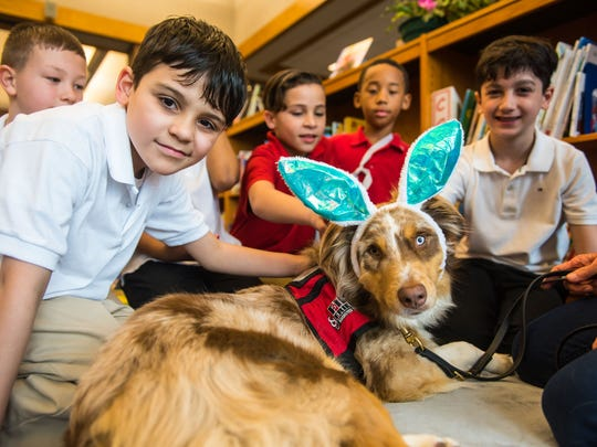 Petway students pose for a photo with Asher the therapy dog at Petway Elementary on Thursday, April 6.