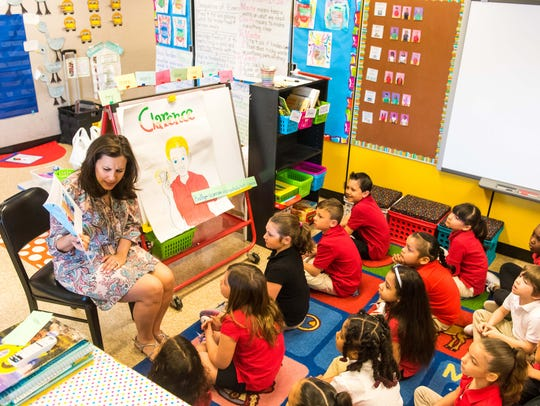 """Stephanie Baruffi reads her book """"Clarence"""" to Ms."""