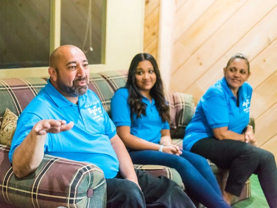 Ozzie Heredia, with Christine Ruiz and wife Lilly, speak with The Daily Journal about the opening of Daniel's Den located at Elmer St and South West Blvd on Tuesday, April 18.