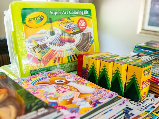Coloring books and crayons collected by Carter Crockett