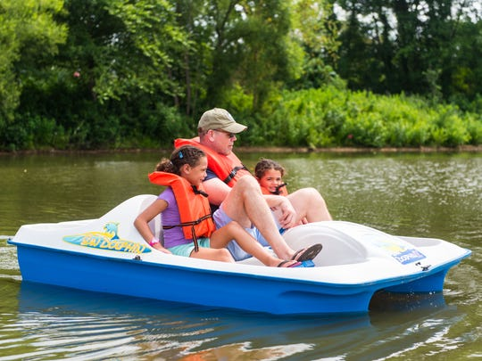 Amelia, Glenn and Keira Stinson take out a paddle boat for Cowboy Mike's Canoe Rental at Cooper River Park last weekend.