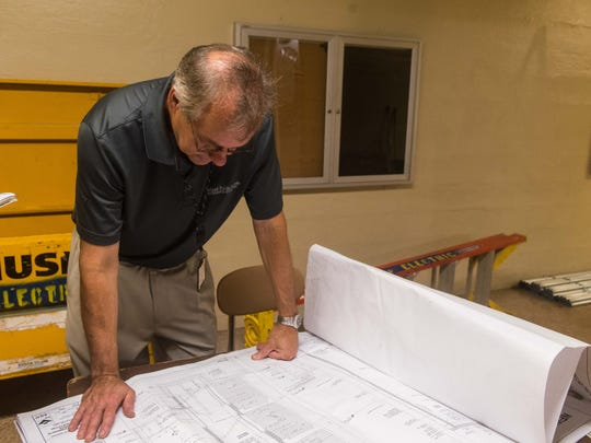 Vineland Public School's Wayne Weaver looks over blueprints
