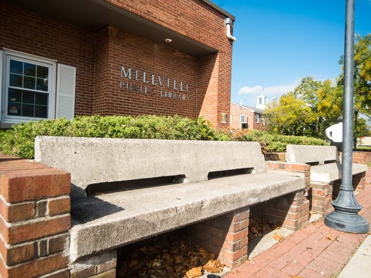 Benches on the exterior of the Millville Public Library