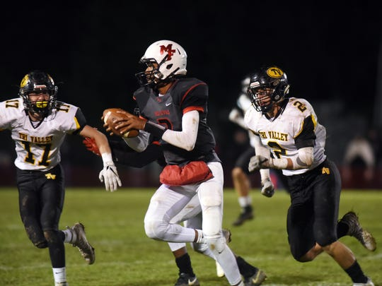 Nathan Lawler, right, tries to chase down Ke'zion Brown during Tri-Valley's 27-18 win against Columbus Marion-Franklin in the playoffs. Lawler was a first-team All-Ohio linebacker.