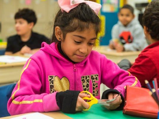 D'Ippolito third grader Nyzirah Padille decorates a