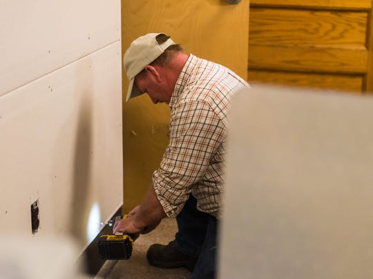 Tony Williams finishes up a wall at the new Vineland