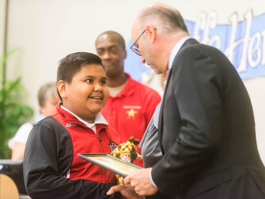 Sabater School student Thomas Garcia Venancio smiles as he is awarded a Giraffe Award during the Giraffe Heroes awards at Cumberland County College on Tuesday, May 22.