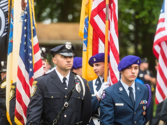 Members of the Cherry Hill Police and Fire Department Honor Guard alongside the Cherry Hill High School West Air Force ROTC present the colors during Cherry Hill Township's Memorial Day 2018 Ceremony at the Cherry Hill Municipal Complex on Monday, May 28.