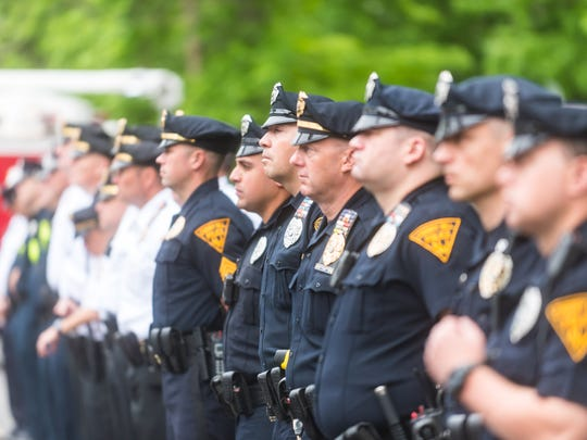 Cherry Hill Police Officers listen to Keynote Speaker Lucretia MClenny, Colono U.S. Army Ret - Consultant to the Vietname War Commoration, during Cherry Hill Township's Memorial Day 2018 Ceremony at the Cherry Hill Municipal Complex on Monday, May 28.
