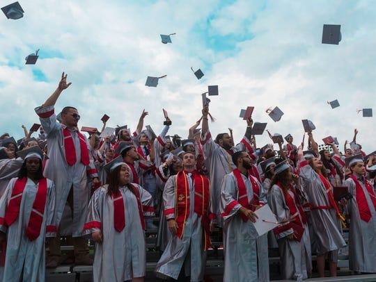 Vineland grads toss their caps during Vineland High