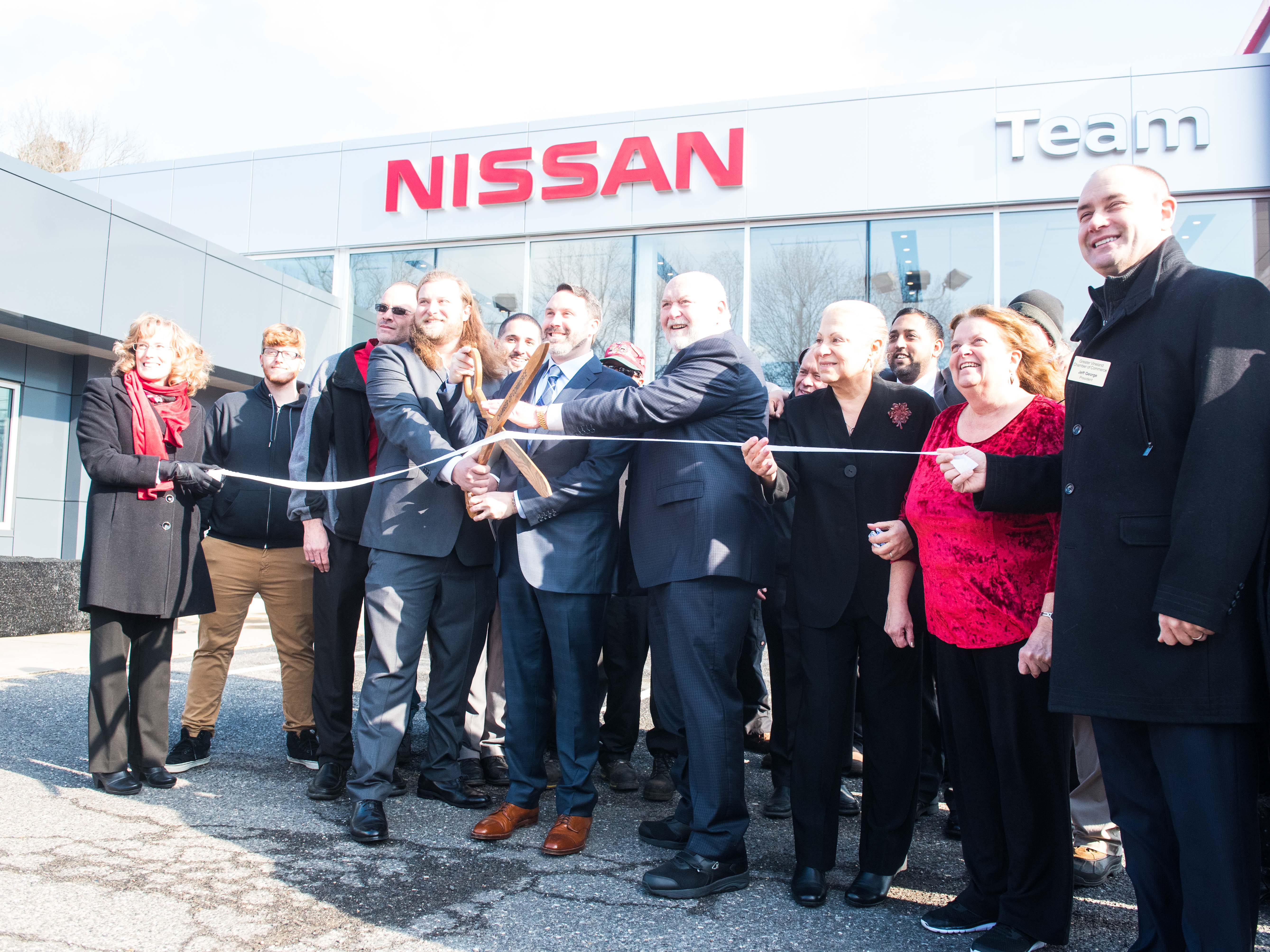 The Ribbon Is Cut At The Reopening Of The Team Nissan