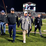 LSU Tigers head coach Les Miles walks off the field after the game against Ole Miss at Vaught-Hemingway Stadium.