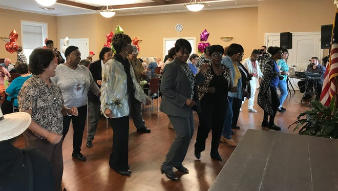 The guests dance to the music at the Cedar Grove Robert O'Toole Community Center during the opening of the senior cafe on Wednesday, May 31, 2017.