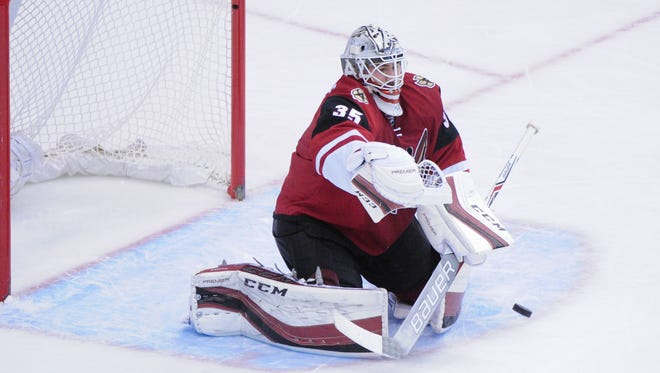Dec 17, 2015: Arizona Coyotes goalie Louis Domingue (35) makes a save during the third period against the Columbus Blue Jackets at Gila River Arena.