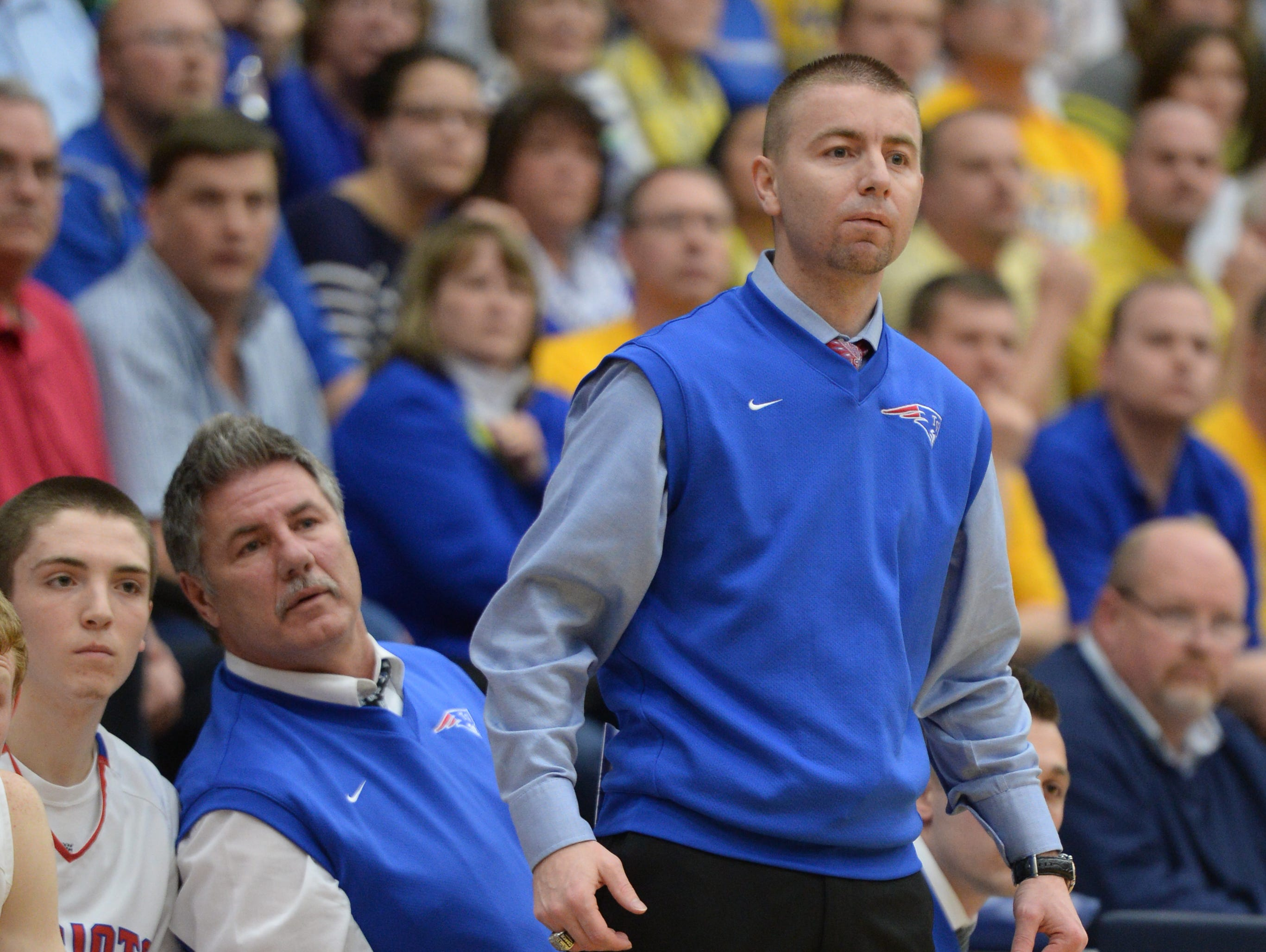 Tri-Village coach Josh Sagester watches a regional basketball game against Russia on March 17 at Kettering Fairmont High School in Ohio.