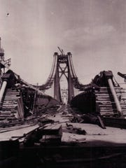 The Mid-Hudson Bridge under construction.